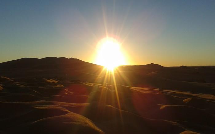заход солнца в дюнах Сахары